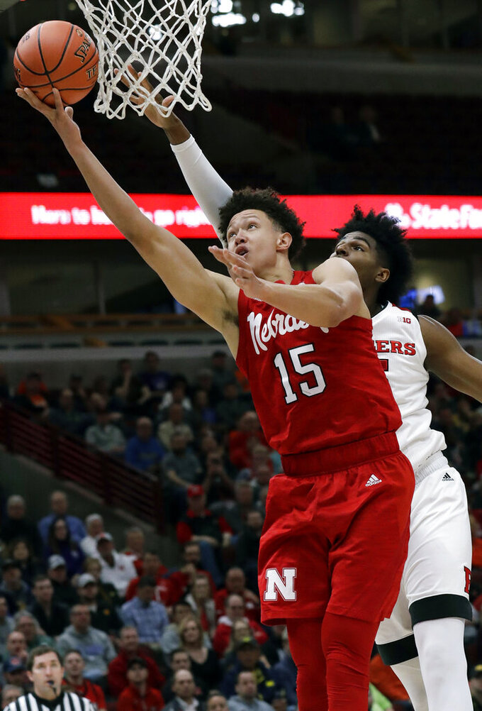 Nebraska forward Isaiah Roby, left, drives to the basket against Rutgers center Myles Johnson during the first half of an NCAA college basketball game in the first round of the Big Ten Conference tournament in Chicago, Wednesday, March 13, 2019. (AP Photo/Nam Y. Huh)