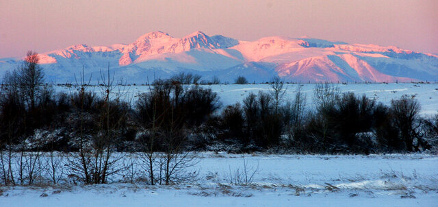 FILE - In this Nov. 12, 2014 file photo, the Beartooth Mountains glow in the morning light just after dawn southeast of Billings, Mont.   Democrats have sought to make public land protections a central issue in Montana and Colorado U.S. Senate races despite a GOP legislative win on the issue.(AP Photo/Matthew Brown, File)