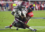 Mississippi linebacker Willie Hibbler (17) tackles Texas A&M running back Isaiah Spiller (28) during the first half of an NCAA college football game in Oxford, Miss., Saturday, Oct. 19, 2019. (AP Photo/Thomas Graning)