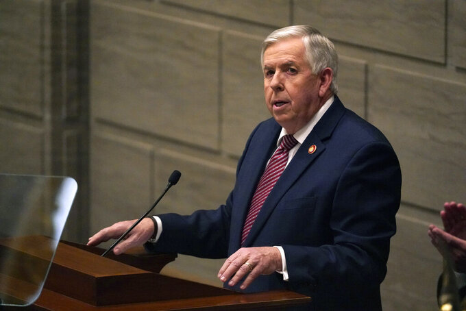 FILE - In this Jan. 27, 2021 file photo, Missouri Gov. Mike Parson delivers the State of the State address in Jefferson City, Mo. Missouri is clashing with the U.S. Department of Justice over a new law banning police from enforcing federal gun rules. In a letter obtained by The Associated Press,Justice Department officials wrotethat state lawmakers went too far with the law and noted that federal law trumps state law under the U.S. Constitution's Supremacy Clause. In response, Parson and Attorney General Eric Schmitt wrote adefiant letterstating that they still plan to enforce the new law. (AP Photo/Jeff Roberson, File)