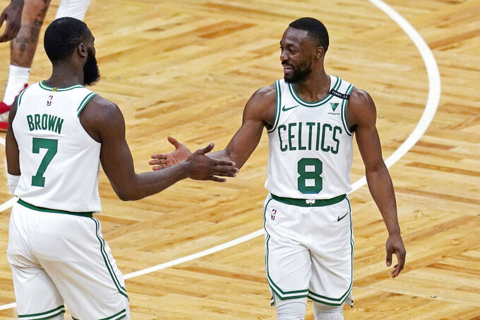 Boston Celtics guard Kemba Walker (8) is congratulated by Jaylen Brown after a basket against the Denver Nuggets during the first half of an NBA basketball game Tuesday, Feb. 16, 2021, in Boston. (AP Photo/Charles Krupa)
