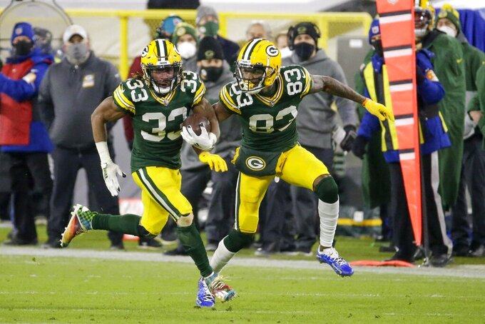 Green Bay Packers' Aaron Jones runs for a 77-yard touchdown during the second half of an NFL football game against the Philadelphia Eagles Sunday, Dec. 6, 2020, in Green Bay, Wis. (AP Photo/Mike Roemer)