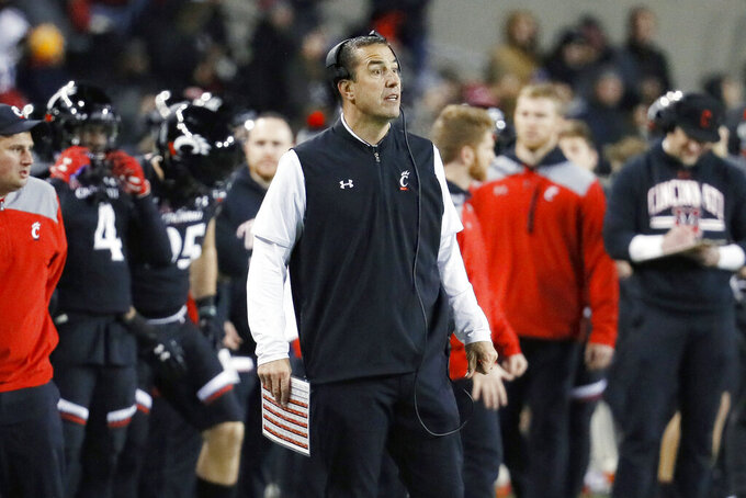 Cincinnati head coach Luke Fickell works the sidelines during the first half of an NCAA college football game against Temple, Saturday, Nov. 23, 2019, in Cincinnati. (AP Photo/John Minchillo)