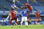 Liverpool's Virgil van Dijk, top right, gets in a header during the English Premier League soccer match between Everton and Liverpool at Goodison Park in Liverpool, England, Sunday, June 21, 2020. (Peter Powell/Pool via AP)