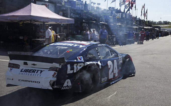 With tires deflated and smoking after a crash, William Byron limps back to the garage during a NASCAR Cup Series auto race practice at New Hampshire Motor Speedway in Loudon, N.H., Saturday, July 20, 2019. (AP Photo/Charles Krupa)
