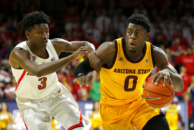 Arizona State guard Luguentz Dort (0) drives past Arizona guard Dylan Smith in the first half during an NCAA college basketball game, Saturday, March 9, 2019, in Tucson, Ariz. (AP Photo/Rick Scuteri)
