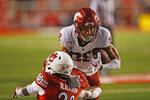 Utah defensive back Julian Blackmon (23) tackles Washington State wide receiver Rodrick Fisher (88) in the first half of an NCAA college football game Saturday, Sept. 28, 2019, in Salt Lake City. (AP Photo/Rick Bowmer)