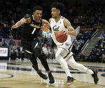 California's Justice Sueing, right, drives the ball against Colorado's Tyler Bey (1) during the first half of an NCAA college basketball game Thursday, Jan. 24, 2019, in Berkeley, Calif. (AP Photo/Ben Margot)