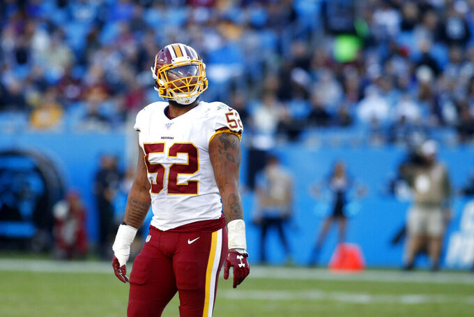 Washington Redskins linebacker Ryan Anderson (52) looks at a replay during the second half of an NFL football game against the Carolina Panthers in Charlotte, N.C., Sunday, Dec. 1, 2019 Andserson was disqualified following a hit on Carolina Panthers tight end Greg Olsen (88). (AP Photo/Brian Blanco)