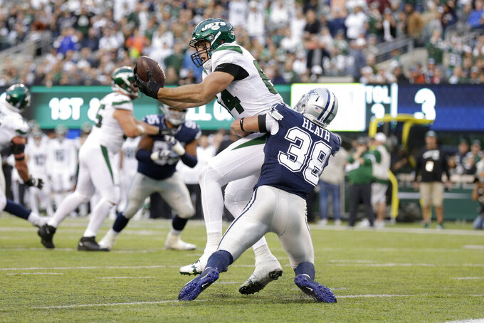 New York Jets' Ryan Griffin, top, makes a catch in front of Dallas Cowboys' Jeff Heath for a touchdown during the first half of an NFL football game, Sunday, Oct. 13, 2019, in East Rutherford, N.J. (AP Photo/Adam Hunger)