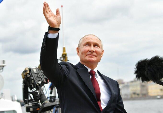 Russian President Vladimir Putin waves to spectators as he leaves the Navy Day parade in St. Petersburg, Russia, Sunday, July 25, 2021. (Alexei Nikolsky, Sputnik, Kremlin Pool Photo via AP)