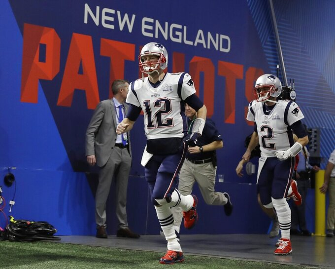 New England Patriots' Tom Brady (12) and Brian Hoyer (2) enter the field, before the NFL Super Bowl 53 football game between the Los Angeles Rams and the New England Patriots Sunday, Feb. 3, 2019, in Atlanta. (AP Photo/Matt Rourke)