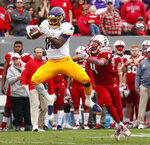 North Carolina State's Nick McCloud (4) defends as East Carolina's Trevon Brown (88) hauls in a pass during the first half of NCAA college football game in Raleigh, N.C., Saturday, Dec. 1, 2018. (AP Photo/Chris Seward)