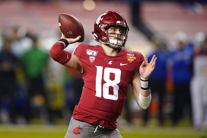 Washington State quarterback Anthony Gordon throws a pass during the first half of the team's Cheez-It Bowl NCAA college football game against Air Force, Friday, Dec. 27, 2019, in Phoenix. (AP Photo/Rick Scuteri)