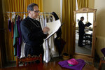 FILE - In this Sunday, March 4, 2018, file photo, Catholic Bishop Oscar A. Solis looks through the order for the Mass on the third Sunday of Lent in Salt Lake City. Prompted by the recent scandal surrounding sexual abuse by Catholic priests across Pennsylvania, the bishop of the Salt Lake City diocese is publicly disclosing Utah's own history of