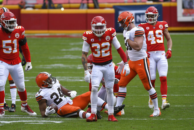 Kansas City Chiefs safety Tyrann Mathieu (32) celebrates after tackling Cleveland Browns running back Nick Chubb (24) during the first half of an NFL divisional round football game, Sunday, Jan. 17, 2021, in Kansas City. (AP Photo/Reed Hoffmann)
