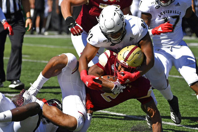 Boston College running back AJ Dillon (2) is brought down by Louisville defensive lineman Malik Clark (92) during the first half of an NCAA college football game in Louisville, Ky., Saturday, Oct. 5, 2019. (AP Photo/Timothy D. Easley)