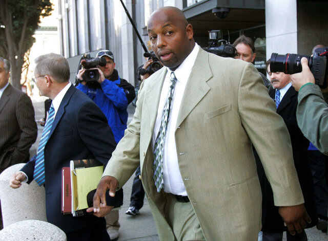 FILE - In this Jan. 18, 2008, file photo, former NFL football player Dana Stubblefield leaves a federal courthouse in San Francisco. Stubblefield was sentenced to 15 years to life in prison, Thursday, Oct. 22, 2020, for raping a prospective babysitter at his Morgan Hill home five years earlier. (AP Photo/Jeff Chiu, File)