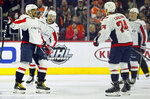 Washington Capitals' Alex Ovechkin celebrates his power play goal along with Evgeny Kuznetsov, rear, John Carlson, front, and T.J. Oshie, right, rear, during the second period of an NHL hockey game against the Philadelphia Flyers, Wednesday, March 6, 2019, in Philadelphia. (AP Photo/Tom Mihalek)