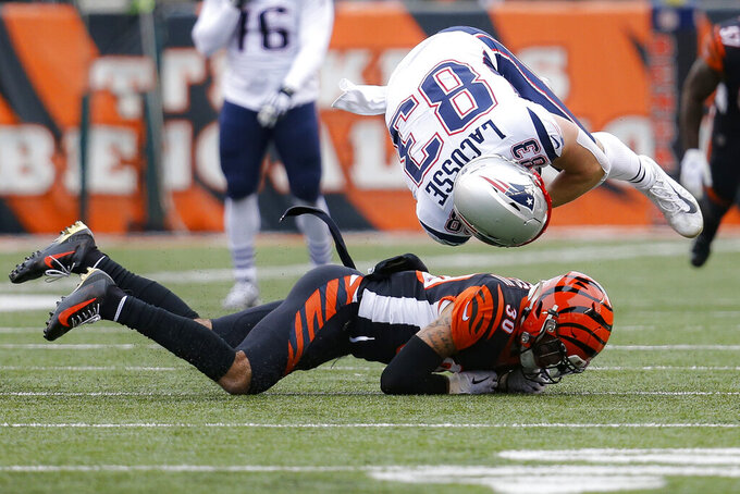 New England Patriots tight end Matt LaCosse (83) is tackled by Cincinnati Bengals free safety Jessie Bates (30) in the first half of an NFL football game, Sunday, Dec. 15, 2019, in Cincinnati. (AP Photo/Frank Victores)