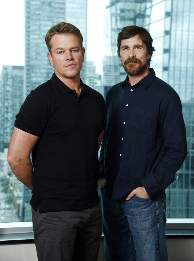 "This Sept. 8, 2019 photo shows co-stars Matt Damon, left, and Christian Bale posing for a portrait to promote their film ""Ford v Ferrari,"" at the St. Regis Hotel during the Toronto International Film Festival. The film, directed by James Mangold, hits theaters on Nov. 15. (Photo by Chris Pizzello/Invision/AP)"