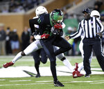 North Texas wide receiver Cudjoe Young (81) carries the ball against Florida Atlantic during the first half of an NCAA college football game, Thursday, Nov. 15, 2018 in Denton, Texas. (Jake King/The Denton Record-Chronicle via AP)