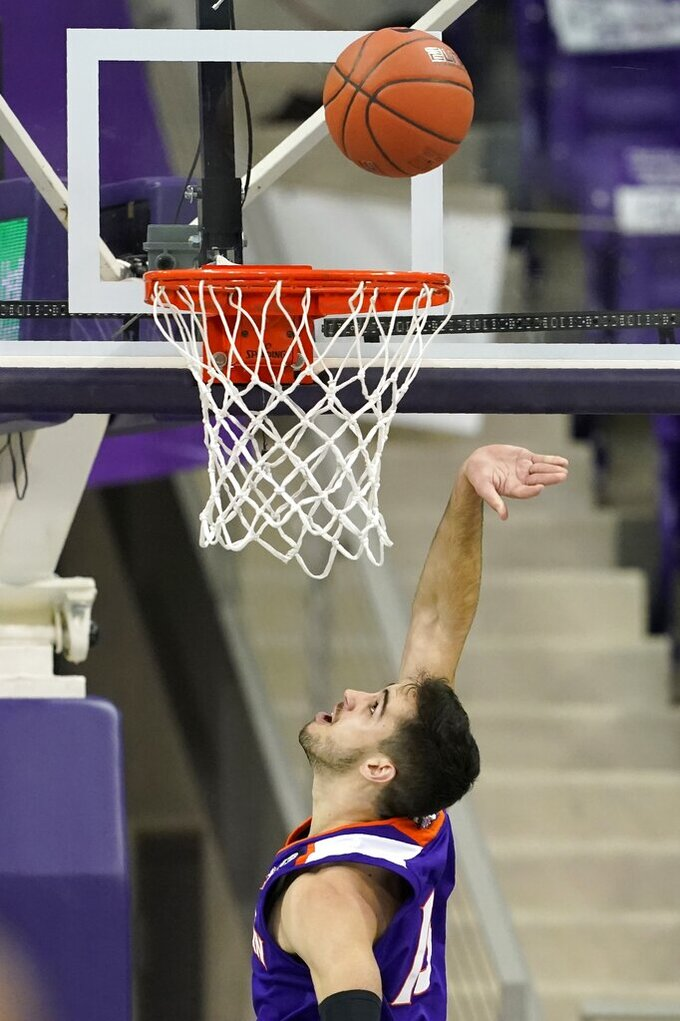 Northwestern State guard Jovan Zelenbaba watches his shot on a breakaway against TCU during the second half of an NCAA college basketball game in Fort Worth, Texas, Thursday, Dec. 3, 2020. (AP Photo/Tony Gutierrez)