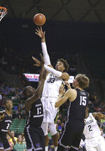 Baylor forward Freddie Gillespie (33) shoots over Central Arkansas guard Collin Cooper (13) and center Hayden Koval (15) in the first half of an NCAA college basketball game Tuesday, Nov. 5, 2019, in Waco, Texas. (AP photo/ Jerry Larson)