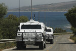 U.N. peacekeeping vehicles patrol on a road that leads to a U.N. post along the border known as Ras Naqoura where Lebanese and Israeli delegations are meeting, in Naqoura, Lebanon, Tuesday, May 4, 2021. After a nearly six-month pause, Lebanon and Israel on Tuesday resumed indirect talks with U.S. mediation over their disputed maritime border. (AP Photo/Hussein Malla)