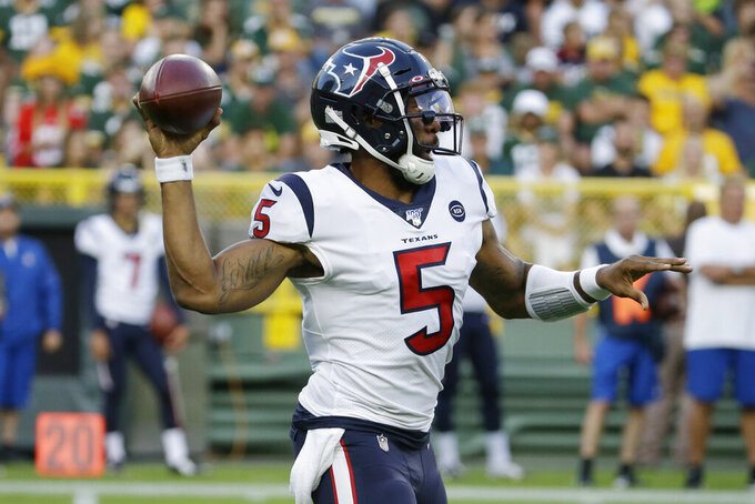Houston Texans quarterback Joe Webb passes the ball against the Green Bay Packers during the first half of an NFL preseason football game Thursday, Aug. 8, 2019, in Green Bay, Wis. (AP Photo/Mike Roemer)