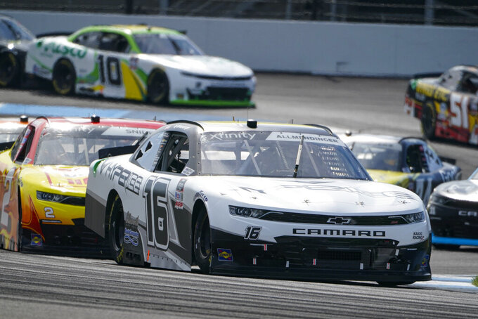 AJ Allmendinger (16) drives through the second turn during the NASCAR Xfinity Series auto race at Indianapolis Motor Speedway in Indianapolis, Saturday, Aug. 14, 2021. (AP Photo/Michael Conroy)