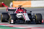 Test driver Robert Kubica streers the Alfa Romeo during the Formula One pre-season testing session at the Barcelona Catalunya racetrack in Montmelo, outside Barcelona, Spain, Wednesday, Feb. 26, 2020. (AP Photo/Joan Monfort)