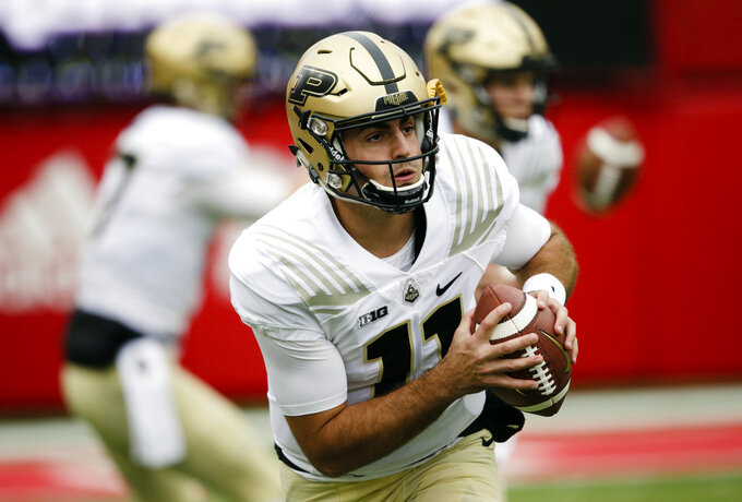 FILE - In this Sept. 29, 2018, file photo, Purdue quarterback David Blough (11) warms up before an NCAA college football game against Nebraska in Lincoln, Neb. Blough has completed 110 of 181 passes (68.3 percent) with 1,573 yards, 10 touchdowns and two interceptions over his last four games.  (AP Photo/Nati Harnik, File)