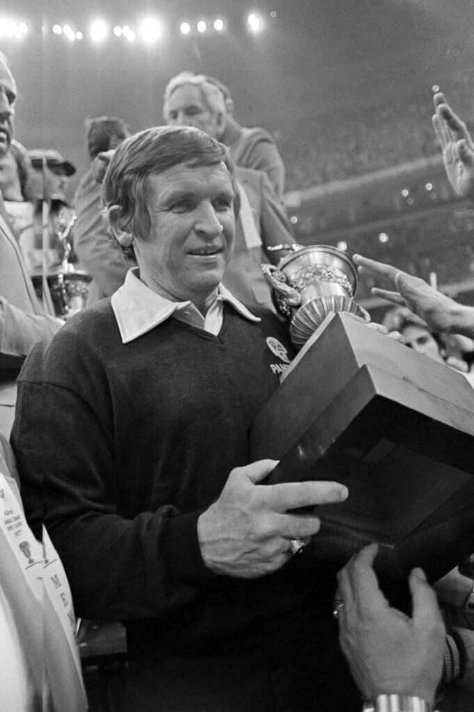 FILE - In this Jan. 3, 1977, file photo, University of Pittsburgh coach Johnny Majors carries the Sugar Bowl trophy after Pittsburgh beat Georgia 27-3 to win the NCAA college football national championship, in New Orleans. Majors, the coach of Pittsburgh's 1976 national championship team and a former coach and star player at Tennessee, has died. He was 85. Majors died Wednesday morning, June 3, 2020, at home in Knoxville, Tenn., according to a statement from his wife, Mary Lynn Majors. (AP Photo/File)