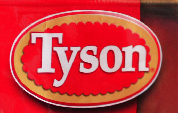 """FILE -This May 8, 2011 file photo shows a Tyson Foods logo. Arkansas-based Tyson Foods is recalling more than 69,000 pounds (31,297 kilograms) of frozen, ready-to-eat chicken strips because they may be contaminated with pieces of metal. The U.S. Agriculture Department on Thursday, March 21, 2019 said the products were produced on Nov. 30, 2018 and have a best if used by date of Nov. 30, 2019. The products have the establishment number """"P-7221"""" on the back of their packages. (AP Photo/Paul Sakuma, File)"""