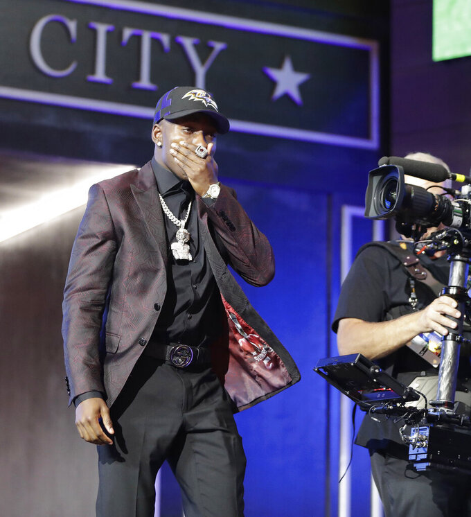 Oklahoma wide receiver Marquise Brown walks on stage after the Baltimore Ravens selected him in the first round at the NFL football draft, Thursday, April 25, 2019, in Nashville, Tenn. (AP Photo/Mark Humphrey)