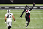 Atlanta Falcons linebacker Deion Jones (45) runs toward the end zone for a touchdown against the Las Vegas Raiders after his interception during the second half of an NFL football game, Sunday, Nov. 29, 2020, in Atlanta. (AP Photo/John Bazemore)