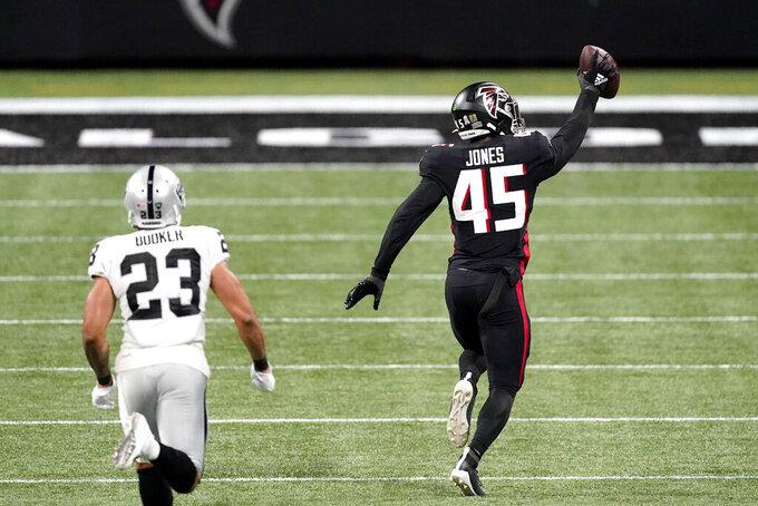 Atlanta Falcons linebacker Deion Jones (45) runs toward the end zone for a touchdown against the Las Vegas Raiders after his interception during the second half of an NFL football game, Sunday, Nov. 29, 2020, in Atlanta. (AP Photo/John Bazemore)