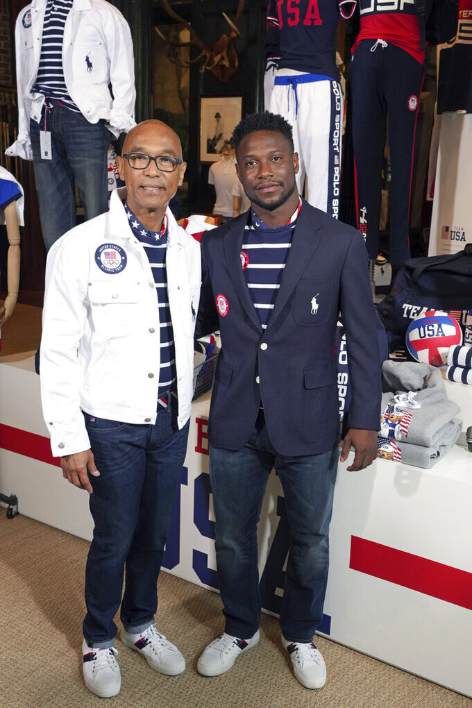 Olympic medalists in fencing, Peter Westbrook, left, and Daryl Homer model the Team USA Tokyo Olympic opening ceremony uniforms at the Ralph Lauren SoHo store on Wednesday, July 7, 2021, in New York. (Photo by Charles Sykes/Invision/AP)