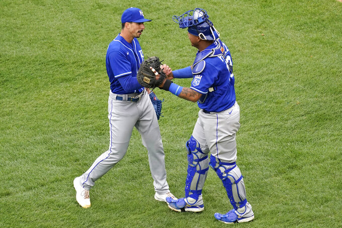 Kansas City Royals relief pitcher Kyle Zimmer, left, celebrates with catcher Salvador Perez after the Kansas City Royals defeated the Chicago White Sox in a baseball game in Chicago, Sunday, April 11, 2021. (AP Photo/Nam Y. Huh)