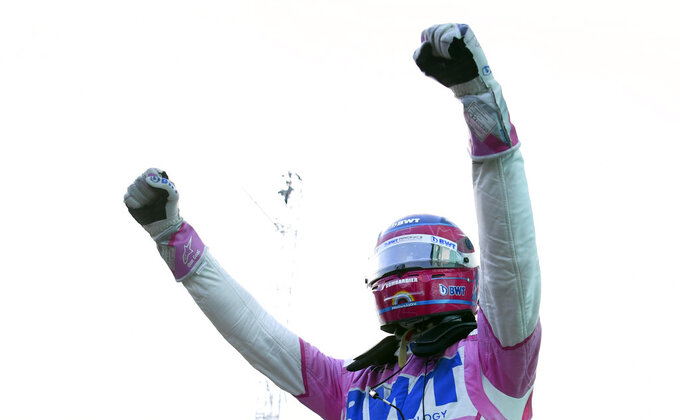 Racing Point driver Lance Stroll of Canada celebrates his pole position after the qualifying session at the Istanbul Park circuit racetrack in Istanbul, Saturday, Nov. 14, 2020. The Formula One Turkish Grand Prix will take place on Sunday. (Clive Mason/Pool via AP)