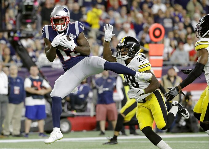New England Patriots wide receiver Phillip Dorsett, left, catches a touchdown pass in front of Pittsburgh Steelers cornerback Mike Hilton in the first half an NFL football game, Sunday, Sept. 8, 2019, in Foxborough, Mass. (AP Photo/Steven Senne)