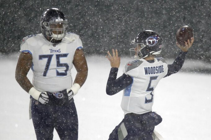 Tennessee Titans' Logan Woodside warms up before an NFL football game against the Green Bay Packers Sunday, Dec. 27, 2020, in Green Bay, Wis. (AP Photo/Matt Ludtke)