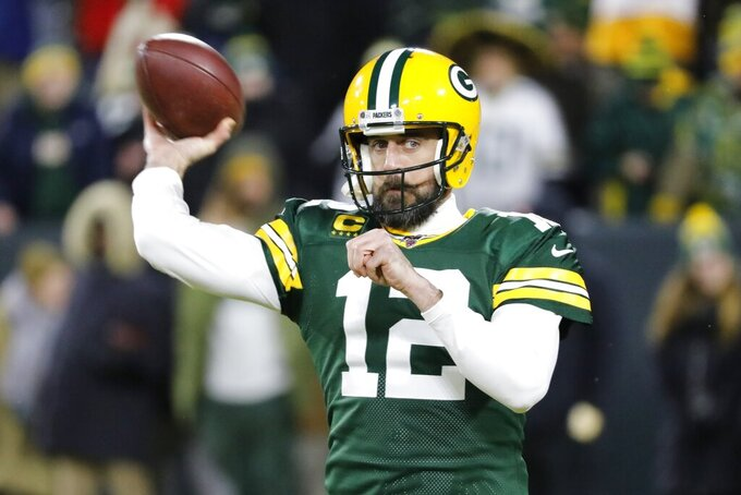 Green Bay Packers quarterback Aaron Rodgers warms up before an NFL divisional playoff football game against the Seattle Seahawks Sunday, Jan. 12, 2020, in Green Bay, Wis. (AP Photo/Mike Roemer)