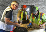 Greg Dimmick, left, Jason Vandervort and Sol Garza sift through dirt during an archaeological survey in the Long Barrack on the Alamo grounds on Tuesday, Aug. 13, 2019. (Billy Calzada/The San Antonio Express-News via AP)