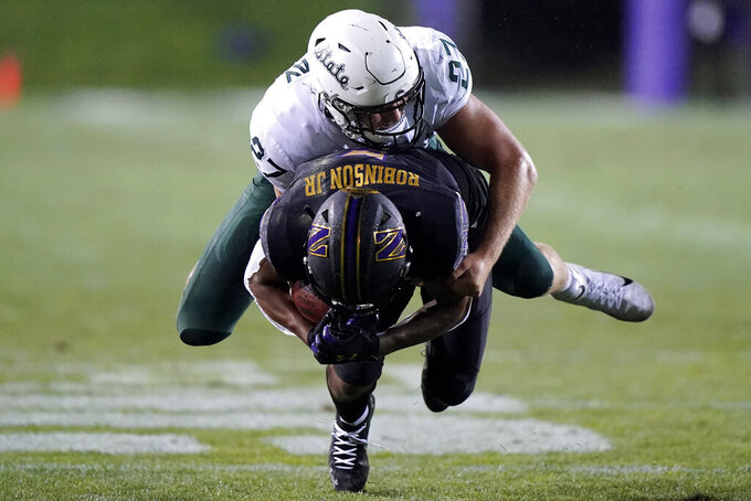 Michigan State linebacker Cal Haladay, top, tackles Northwestern wide receiver Stephon Robinson Jr. during the second half of an NCAA college football game in Evanston, Ill., Friday, Sept. 3, 2021. Michigan State won 38-21. (AP Photo/Nam Y. Huh)