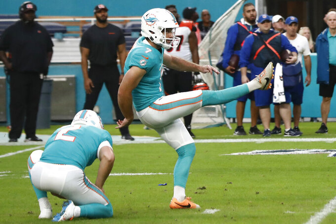 FILE - Miami Dolphins kicker Jason Sanders (7) kicks the game-winning field goal against the Cincinnati Bengals during overtime at an NFL football game in Miami Gardens, Fla., in this Sunday, Dec. 22, 2019, file photo. Sanders was selected Friday, Jan. 8, 2021, to The Associated Press All-Pro Team. (AP Photo/Brynn Anderson, File)