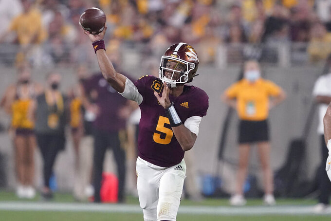 Arizona State quarterback Jayden Daniels (5) throws against UNLV during the first half of an NCAA college football game, Saturday, Sept. 11, 2021, in Tempe, Ariz. (AP Photo/Matt York)