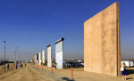 FILE- This Oct. 26, 2017 file photo shows prototypes of border walls in San Diego. President Donald Trump is not giving up on his demands for $5.7 billion to build a wall along the U.S.-Mexico border, saying a physical barrier is central to any strategy for addressing the security and humanitarian crisis at the southern border. Democrats argue that funding the construction of a steel barrier along roughly 234 miles will not solve the problems. (AP Photo/Elliott Spagat, File)