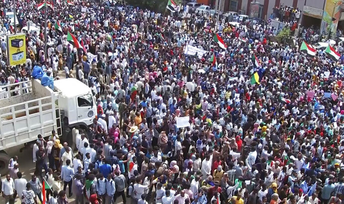 In this frame grab from video thousands of Sudanese rally on the streets of the capital and marched to the presidential palace, in Khartoum, Sudan, Thursday, Sept. 12, 2019. The protesters demanded the sacking of the judiciary chief and the general prosecutor over their alleged ties to ousted autocrat Omar al-Bashir's government. (AP Photo)